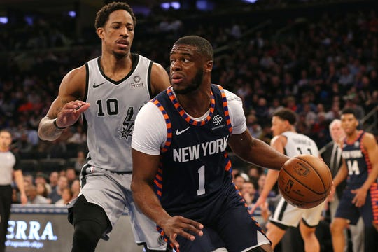 New York Knicks point guard Emmanuel Mudiay (1) drives past San Antonio Spurs shooting guard DeMar DeRozan (10) during the second quarter at Madison Square Garden.