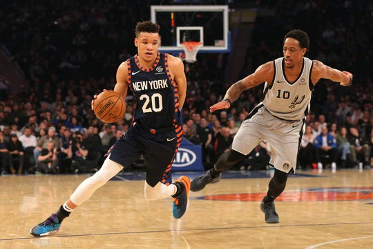 New York Knicks small forward Kevin Knox (20) controls the ball against San Antonio Spurs shooting guard DeMar DeRozan (10) during the first quarter at Madison Square Garden.