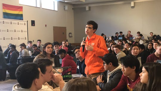 Tomás Carlson, a Ridgewood High School student, talks with peers about ways to fight school segregation. Feb. 21, 2019.