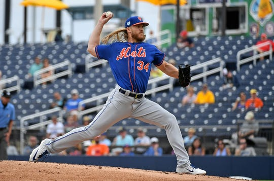 Feb 25, 2019; West Palm Beach, FL, USA; New York Mets starting pitcher Noah Syndergaard (34) delivers a pitch in the first inning against the Houston Astros during a spring training game at FITTEAM Ballpark of the Palm Beaches.
