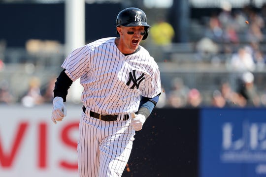 New York Yankees shortstop Troy Tulowitzki (12) celebrates after hitting a home run during the first inning against the Toronto Blue Jays  at George M. Steinbrenner Field.
