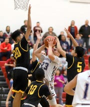 Senior Wildcat Demetri Maldonado (23) was surrounded by a pack of Tigers near the basket.