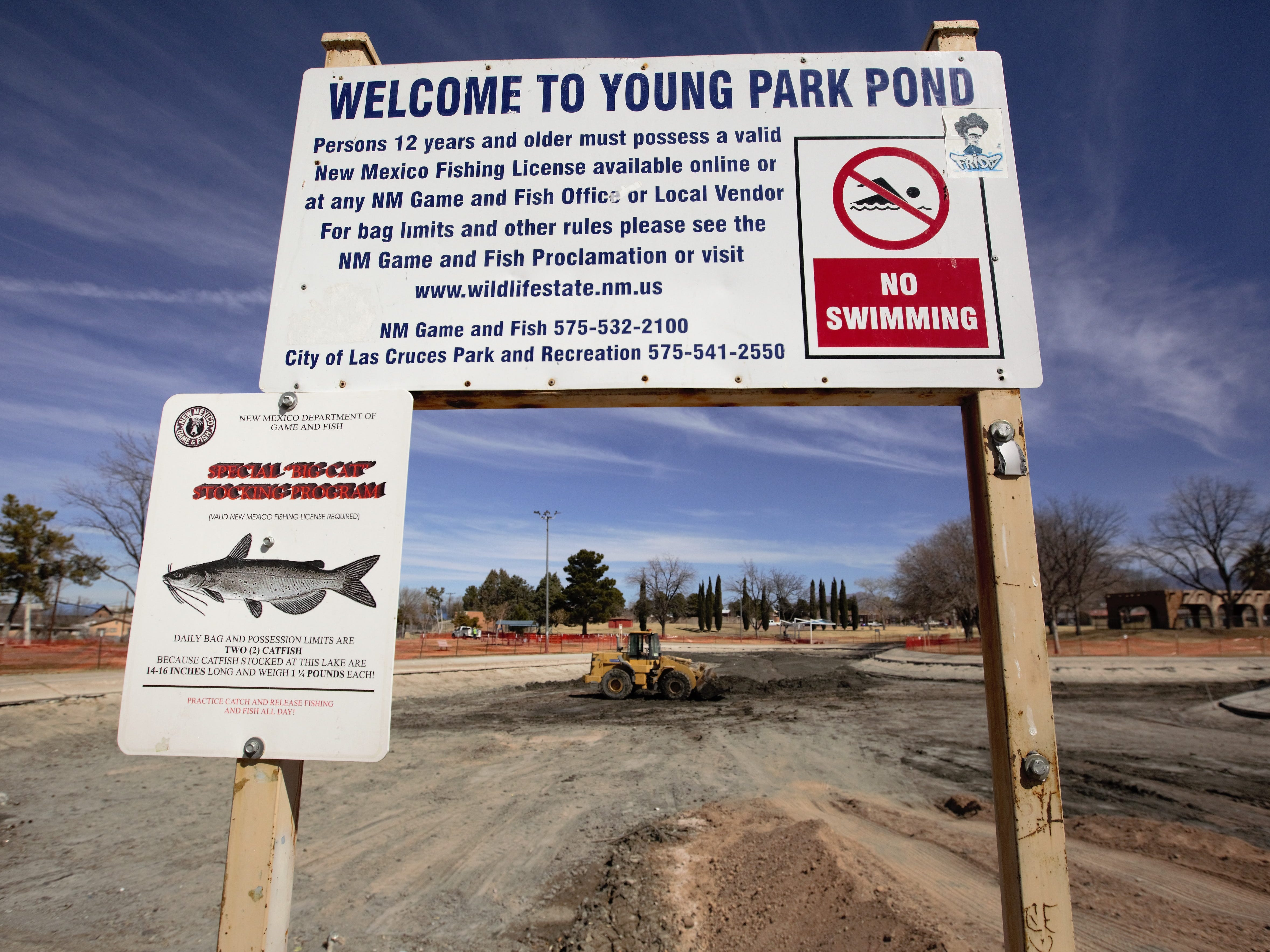 """A """"no swimming"""" sign seen Monday, Feb. 25, 2019 seems comical in light of an ongoing Young Park Pond restoration project that resulted in the pond being drained, at least for now."""