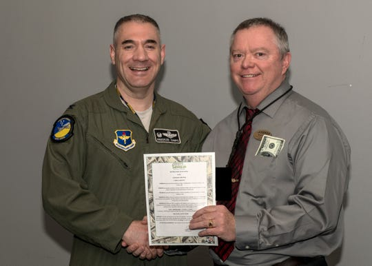 Col. Joseph Campo, 49th Wing commander, poses for a photo with Bruce Knee, 49th Force Support Squadron's Airman and Family Readiness Center community readiness consultant and personal financial manager, Feb. 20, 2019, on Holloman Air Force Base, N.M. Campo signed the Military Saves Week 2019 proclamation, kick starting an educational week of financial readiness and success.