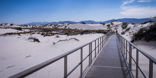 The Interdune Boardwalk is an elevated boardwalk that leads you through the fragile interdune area to a scenic view of the dunefield and the Sacramento mountains.
