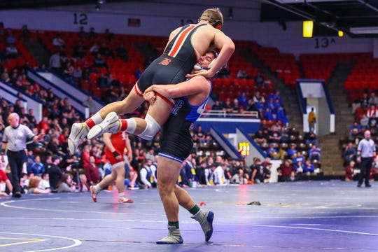 Detroit Catholic Central's Brendin Yatooma defeated Brighton's Luke Stanton in the 215-pound weight class during the team state finals.