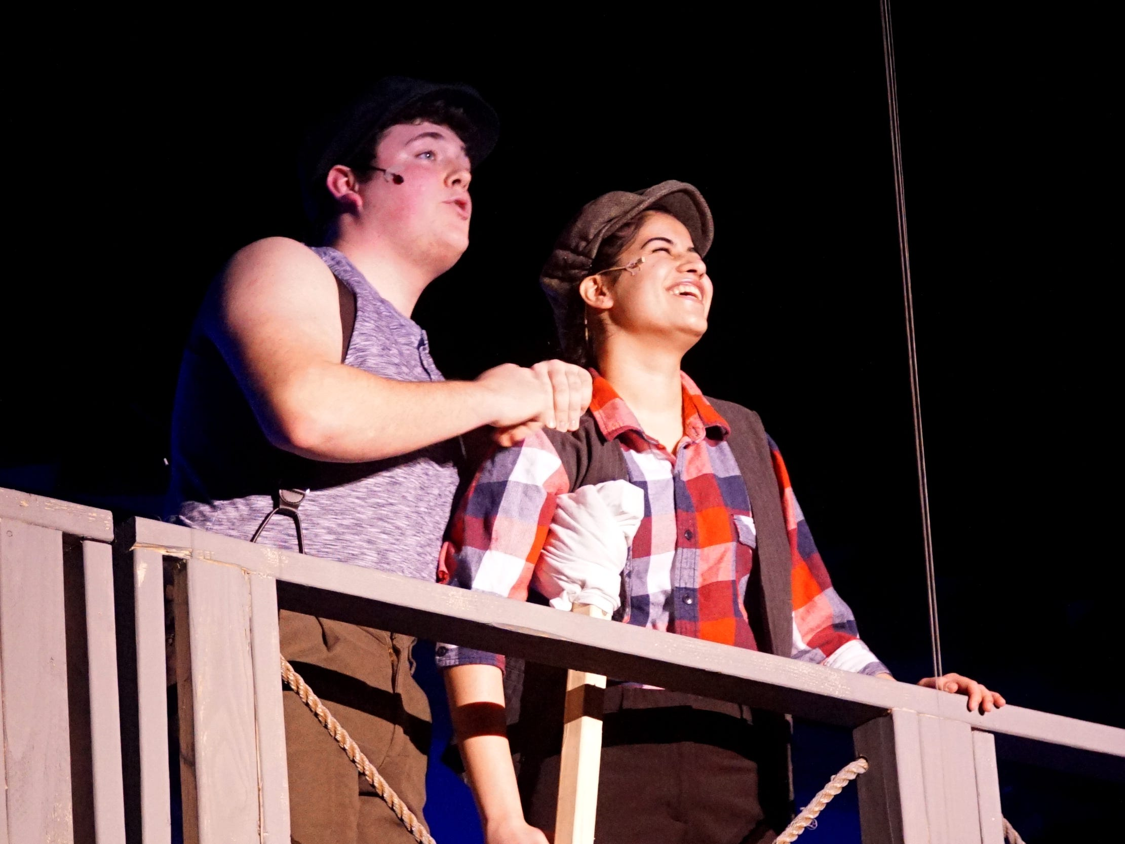Jack Kelly (Ethan Langan), left, and Crutchy (Grace Ajo) rehearse a scene from the musical Newsies at Mercy High School in Farmington Hills on Feb. 25. The school will perform the play on March 8th and 9th at 7:30 p.m., and on March 10 at 2 p.m.