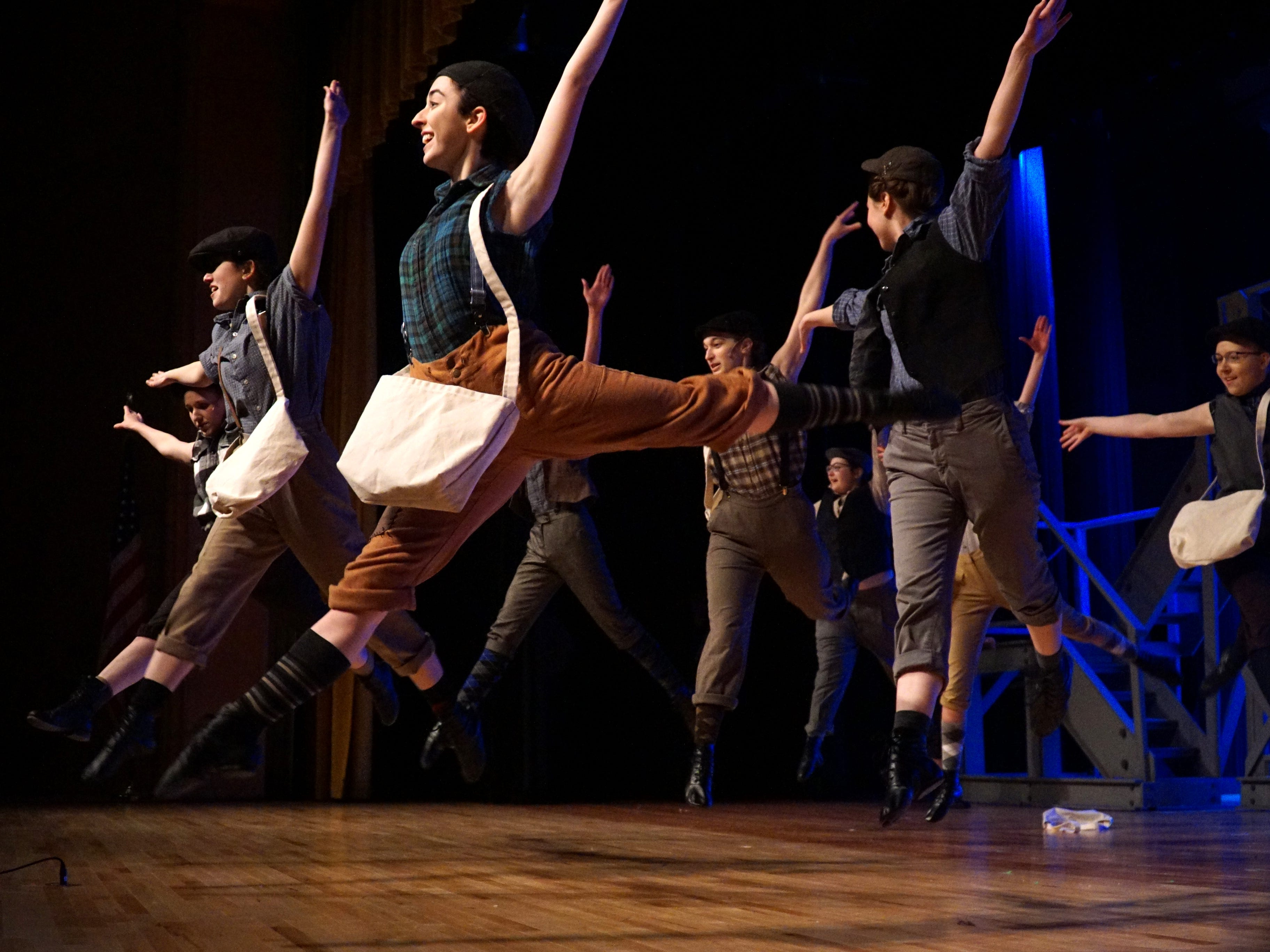 Dancers perform a scene from Mercy High's musical Newsies.