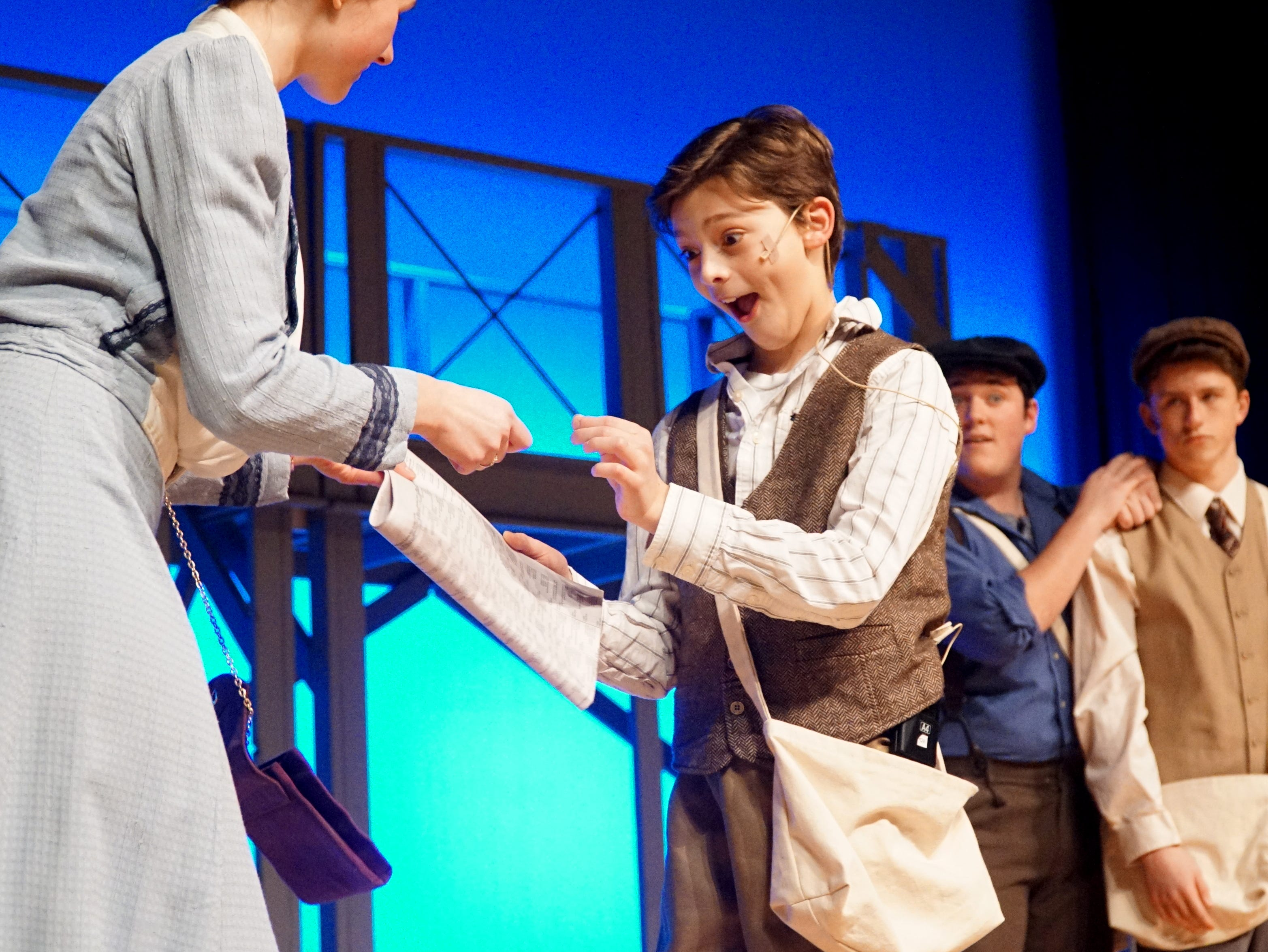 Les (Quinlan Welch), center, rehearses a scene from Mercy High's Newsies on Feb. 25 at the Farmington Hills high school.