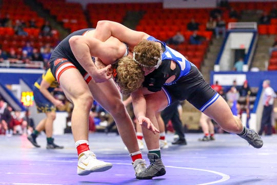 Detroit Catholic Central's Easton Turner defeated Brighton's Greyson Stevens in the 189-pound weight class in the state team finals.