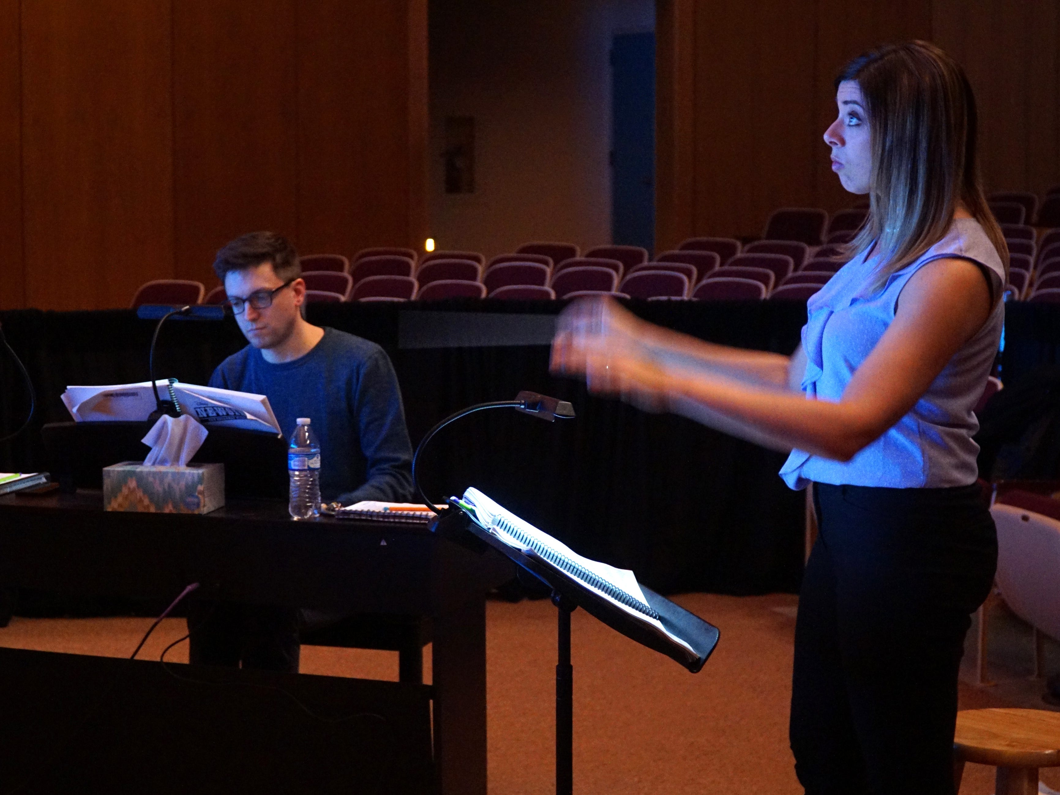 The music director and a pianist work with the students at Mercy High's production of Newsies.