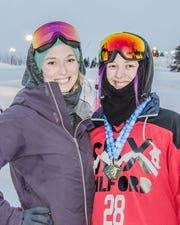 Milford snowboard cross coach Andie Dawson poses with back-to-back state individual champion Evan Hughes.