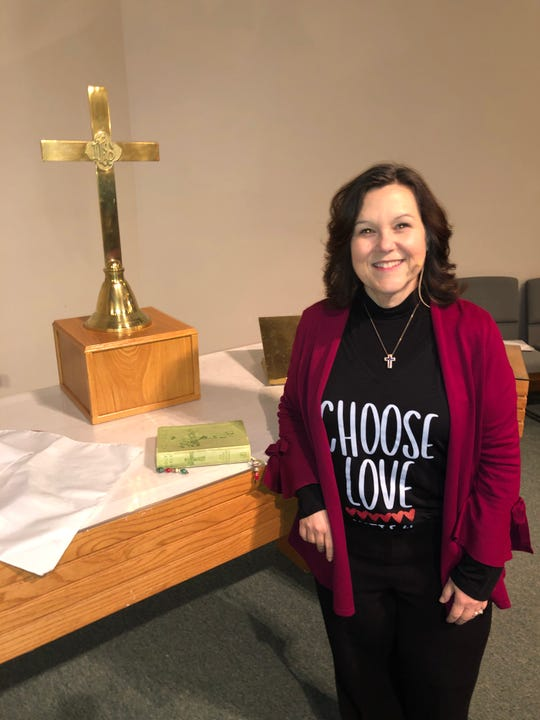 South Lyon First United Methodist Church Pastor Mary McInnes at the altar, with the Holy Bible,  at the heart of a debate over whether the church should ordain gay clergy and perform same sex weddings.