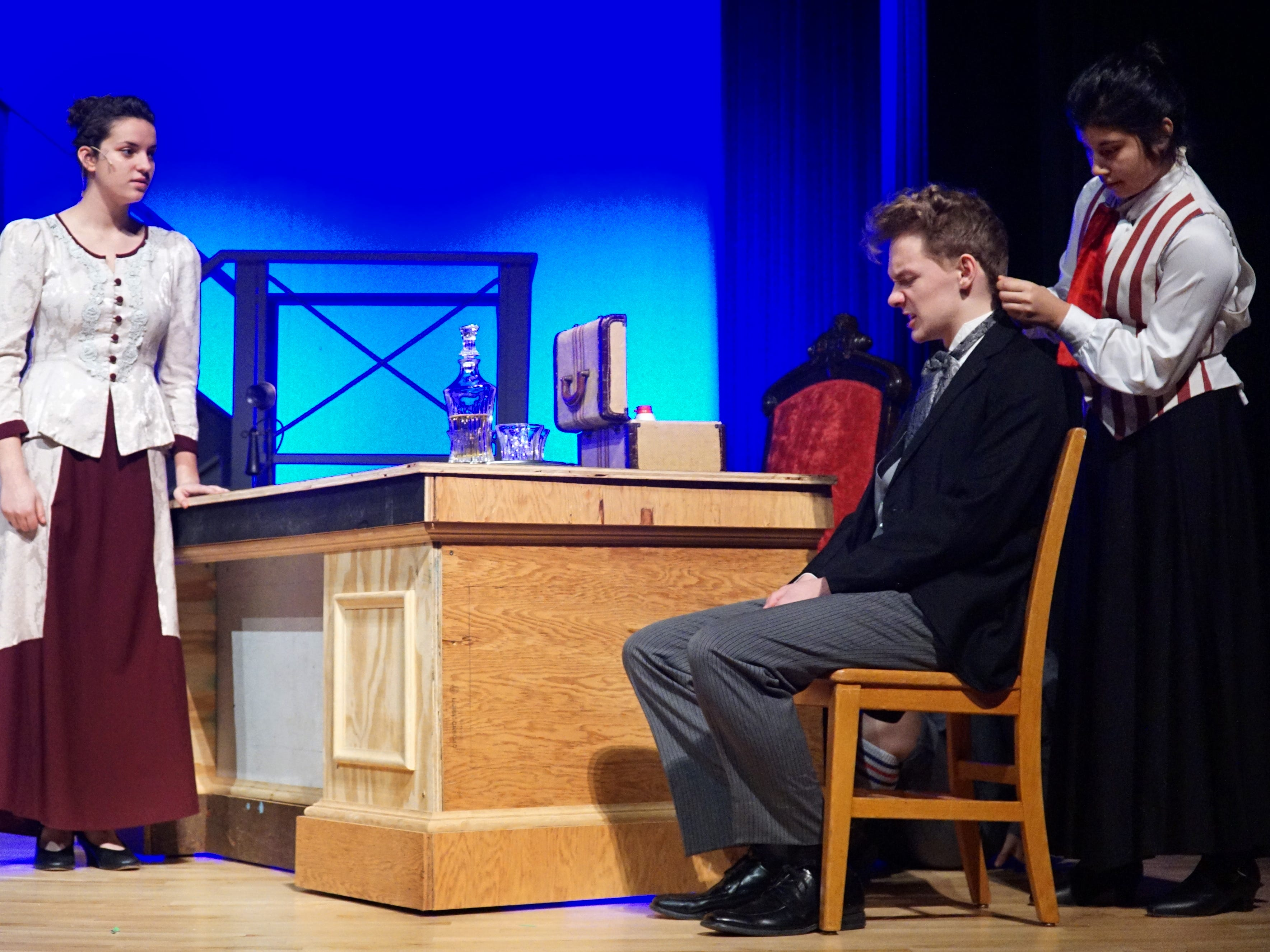 Joseph Pulitzer, right, (Isaac Cantrell) and two actresses from Mercy High perform a scene from the upcoming production of Newsies. The play is being staged at Mercy with its female students and male students from surrounding schools including Orchard Lake St. Mary's, Detroit Catholic Central, Livonia Stevenson and Plymouth Christian.