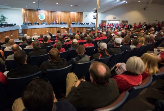 More than 100 members of the Home Builders Association of West Florida flooded the Santa Rosa County Commission meeting Monday to voice their support for the the county's growing construction industry.