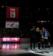 Shane Doan (L-R) stands with his wife Andrea Doan, and children Carson, Josh and Karys as the 19 from his jersey ascends to the rafters during a jersey retirement ceremony for Shane Doan at Gila River Arena in Glendale, Ariz. on February 24, 2019.