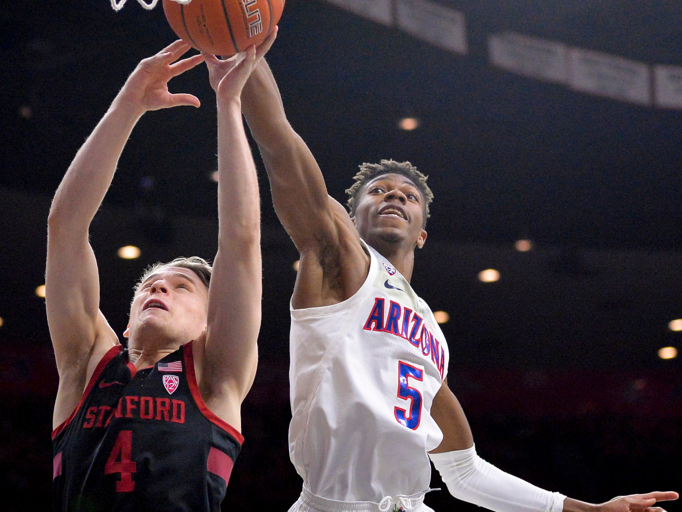 Feb 24, 2019: Stanford Cardinal guard Isaac White (4) and Arizona Wildcats guard Brandon Randolph (5) battle for a rebound during the second half at McKale Center.