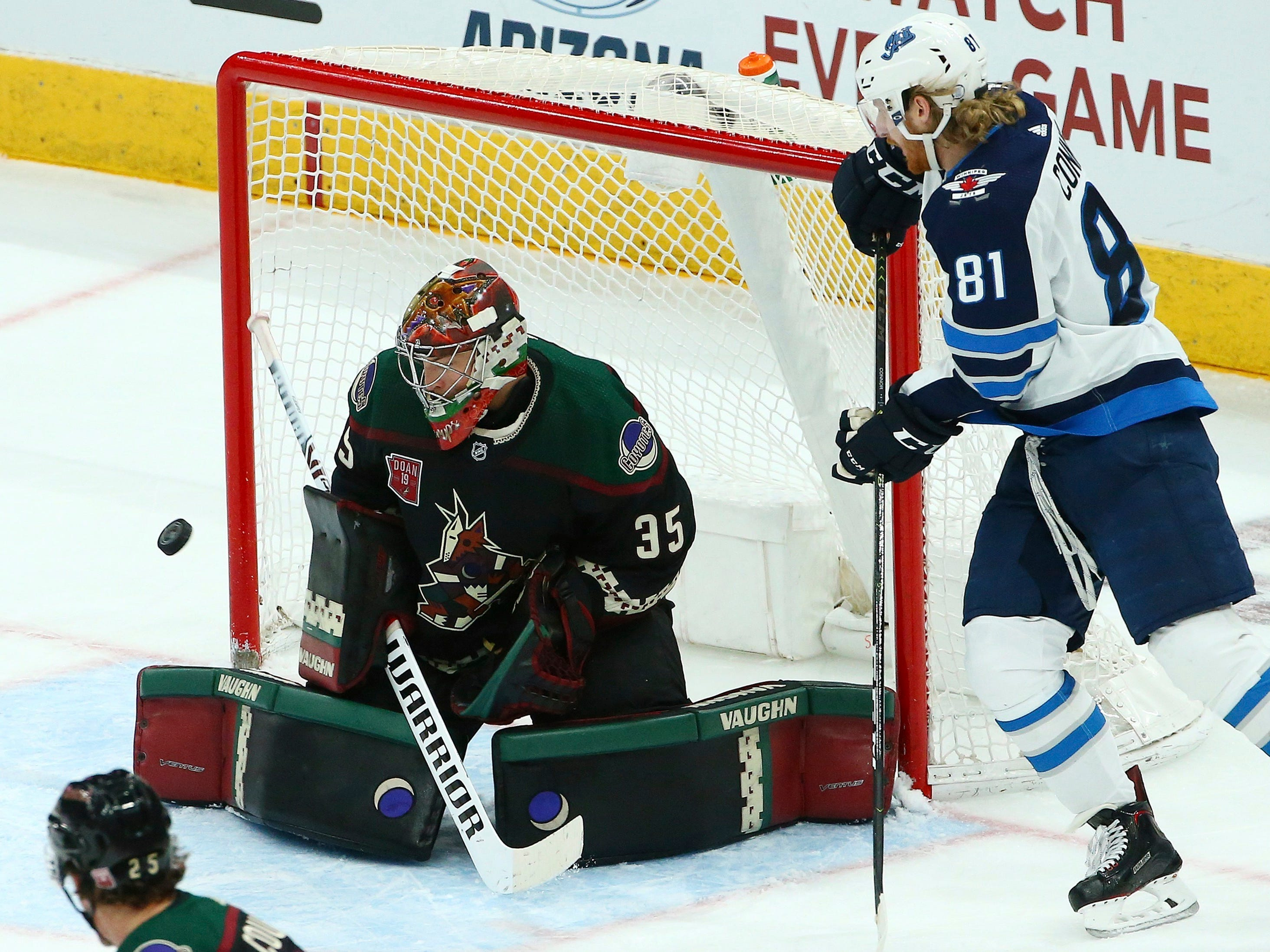 Arizona Coyotes goaltender Darcy Kuemper (35) makes a save on a shot by Winnipeg Jets left wing Kyle Connor (81) during the second period of an NHL hockey game Sunday, Feb. 24, 2019, in Glendale, Ariz.