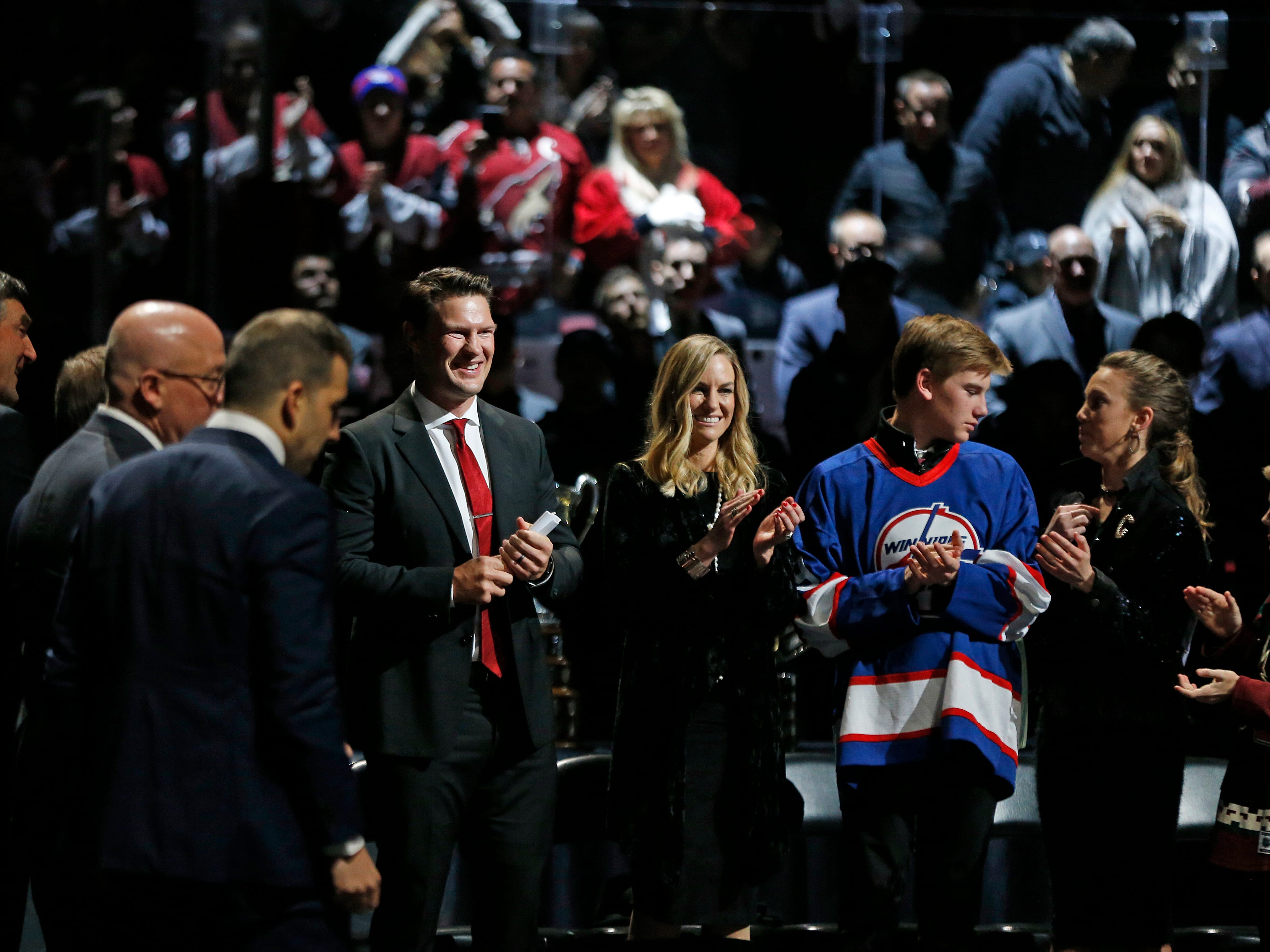 Shane Doan smiles as he receives a standing ovation next to his wife Andrea during his jersey retirement ceremony at Gila River Arena in Glendale, Ariz. on February 24, 2019.