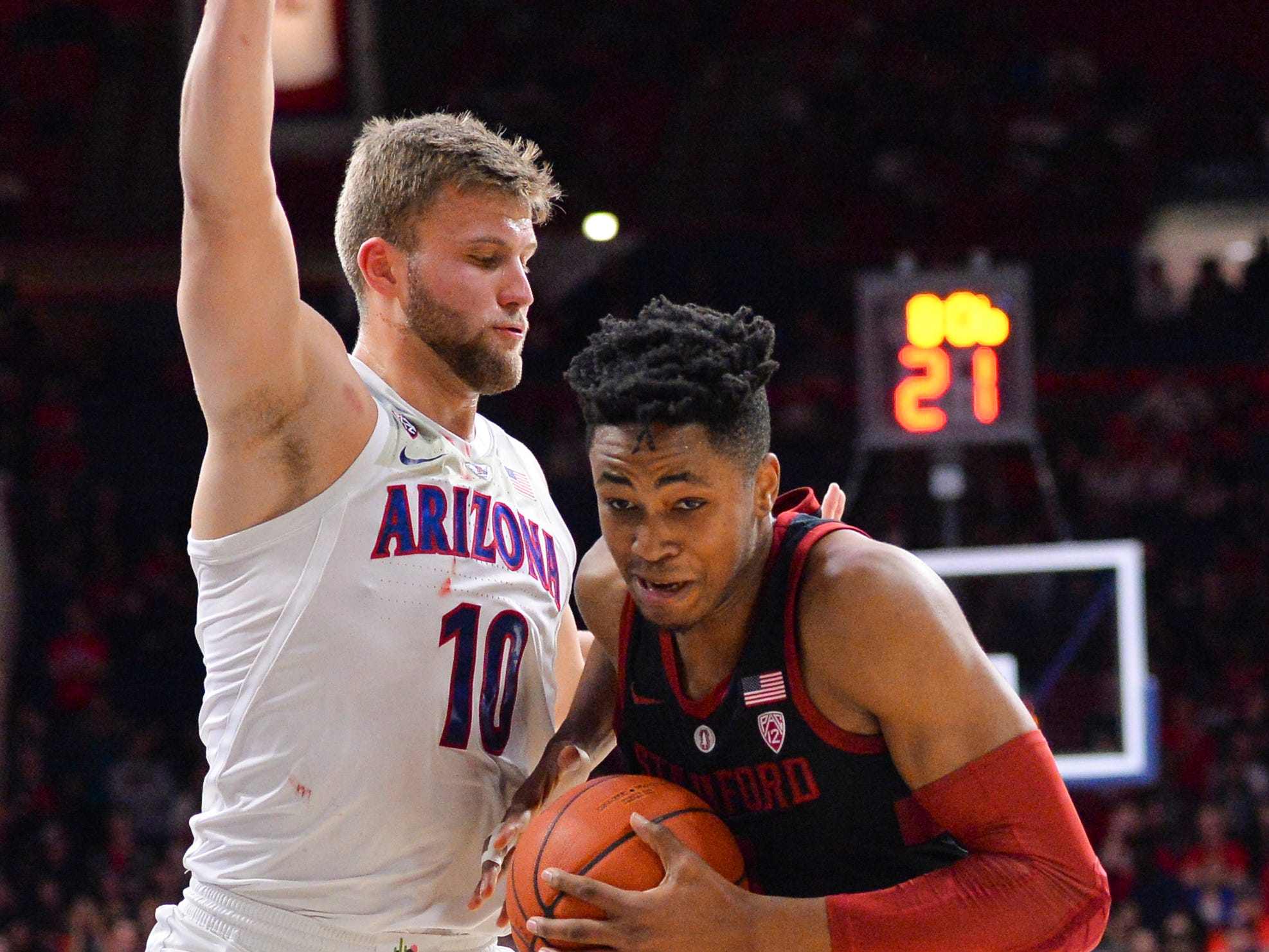 Feb 24, 2019: Stanford Cardinal forward KZ Okpala (0) drives to the basket against Arizona Wildcats forward Ryan Luther (10) during the first half at McKale Center.