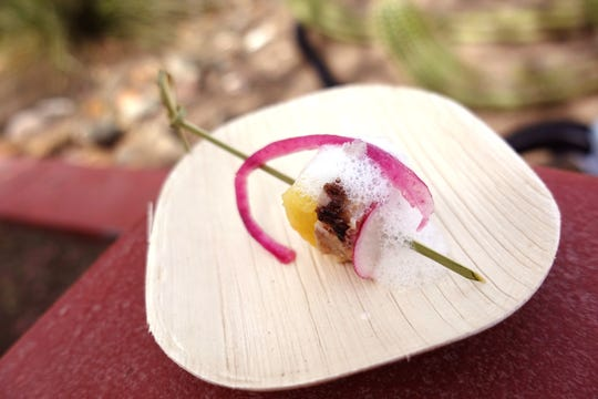 Cutino's miso-cured and grilled hamachi with preserved pineapple, pickled red onion and All About the 'Booch pineapple ginger emulsion from The Larder + The Delta at the 2019 Devour Culinary Classic at the Desert Botanical Garden in Phoenix.