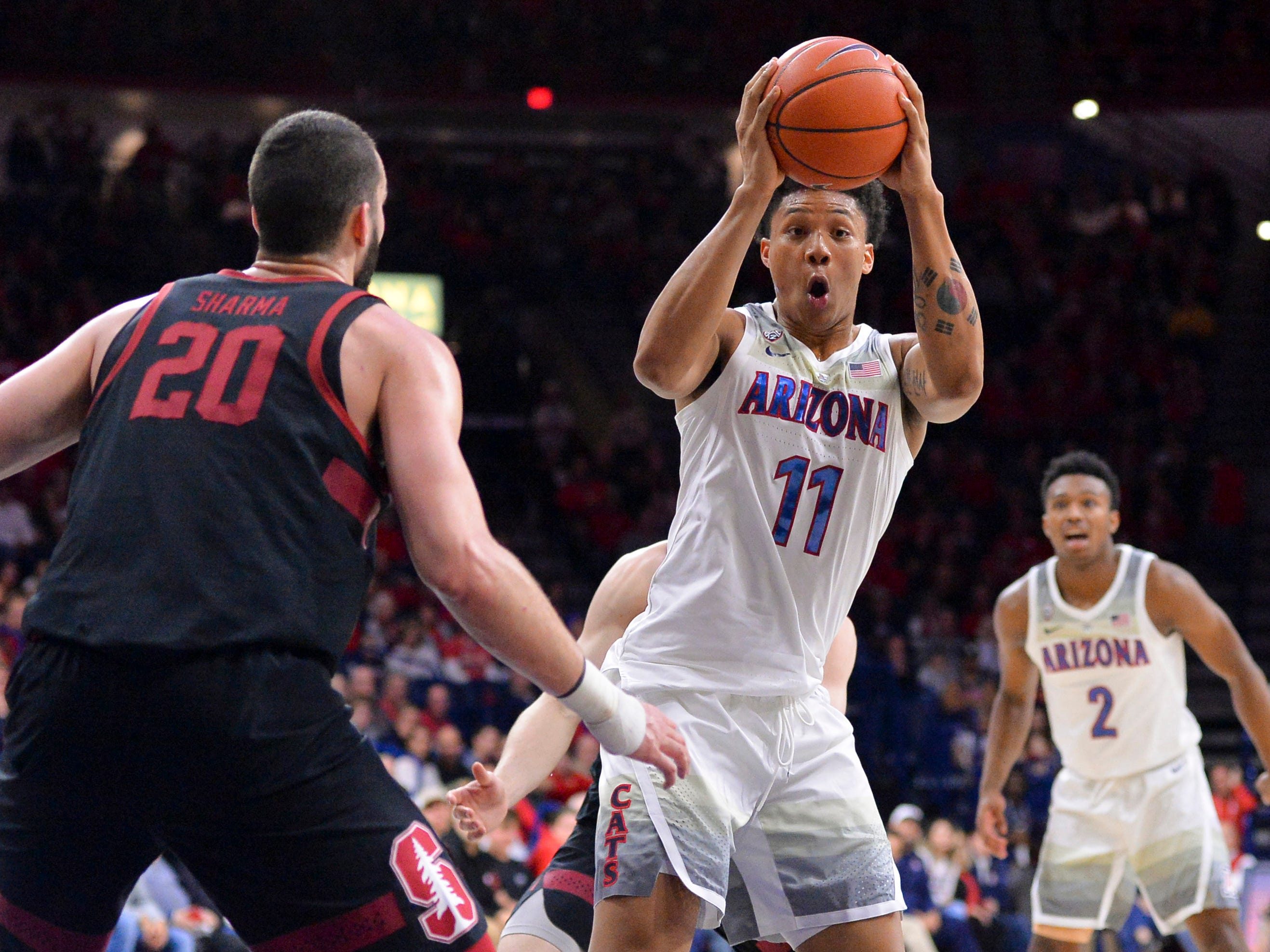 Feb 24, 2019: Arizona Wildcats forward Ira Lee (11) looks to pass the ball against Stanford Cardinal center Josh Sharma (20) during the second half at McKale Center.