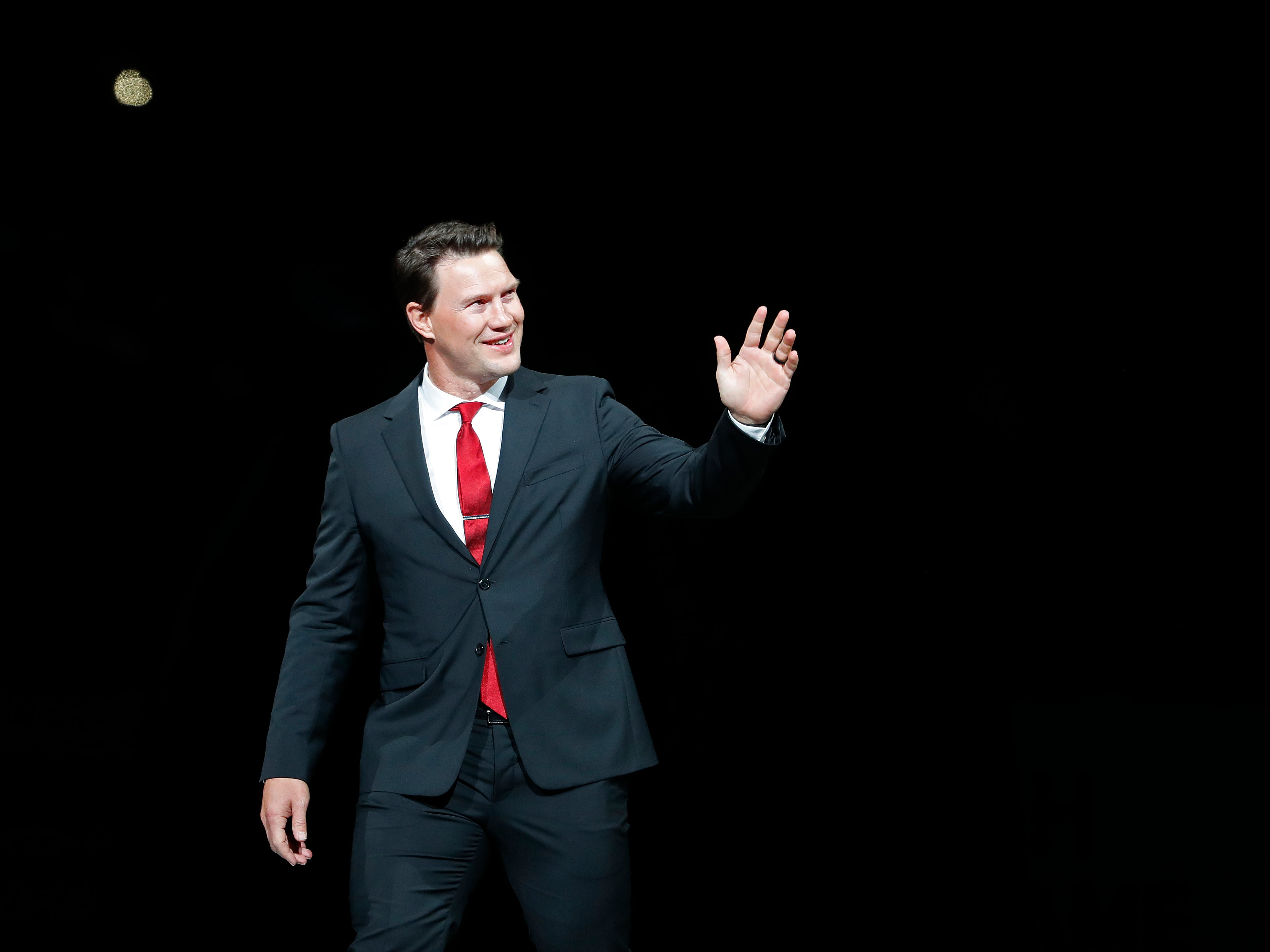 Shane Doan waves to fans as he receives a standing ovation during the jersey retirement ceremony at Gila River Arena in Glendale, Ariz. on February 24, 2019.