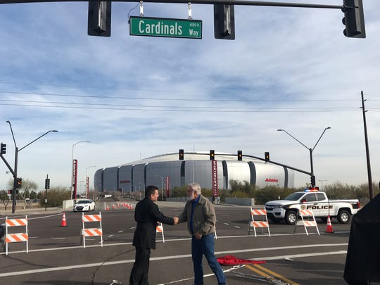 Cardinals President Michael Bidwill (left) and Glendale Mayor Jerry Weiers shake hands after the unveiling of Cardinals Way in Glendale.