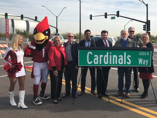 The Glendale City Council poses with Big Red at the unveiling of Cardinals Way in Glendale.