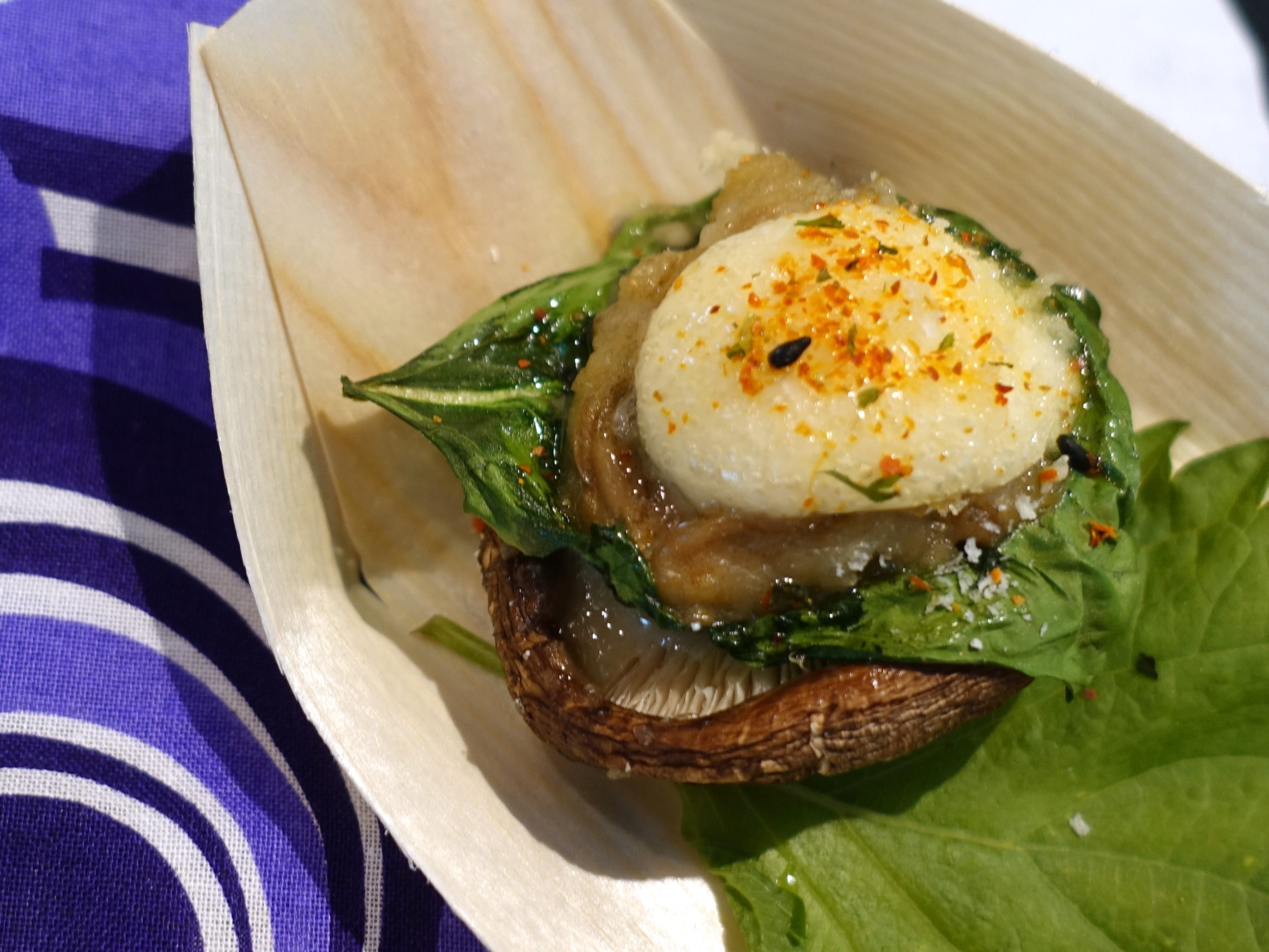 Oyster-stuffed shiitake mushroom with spinach, Kewpie mayonnaise, togarashi and Parmigiano Reggiano from Hana Japanese Eatery at the 2019 Devour Culinary Classic at the Desert Botanical Garden in Phoenix.