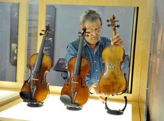 Amnon Weinstein and the Violins of Hope in exhibition at the University of North Carolina at Charlotte. The exhibit is in the Valley through the end of March.