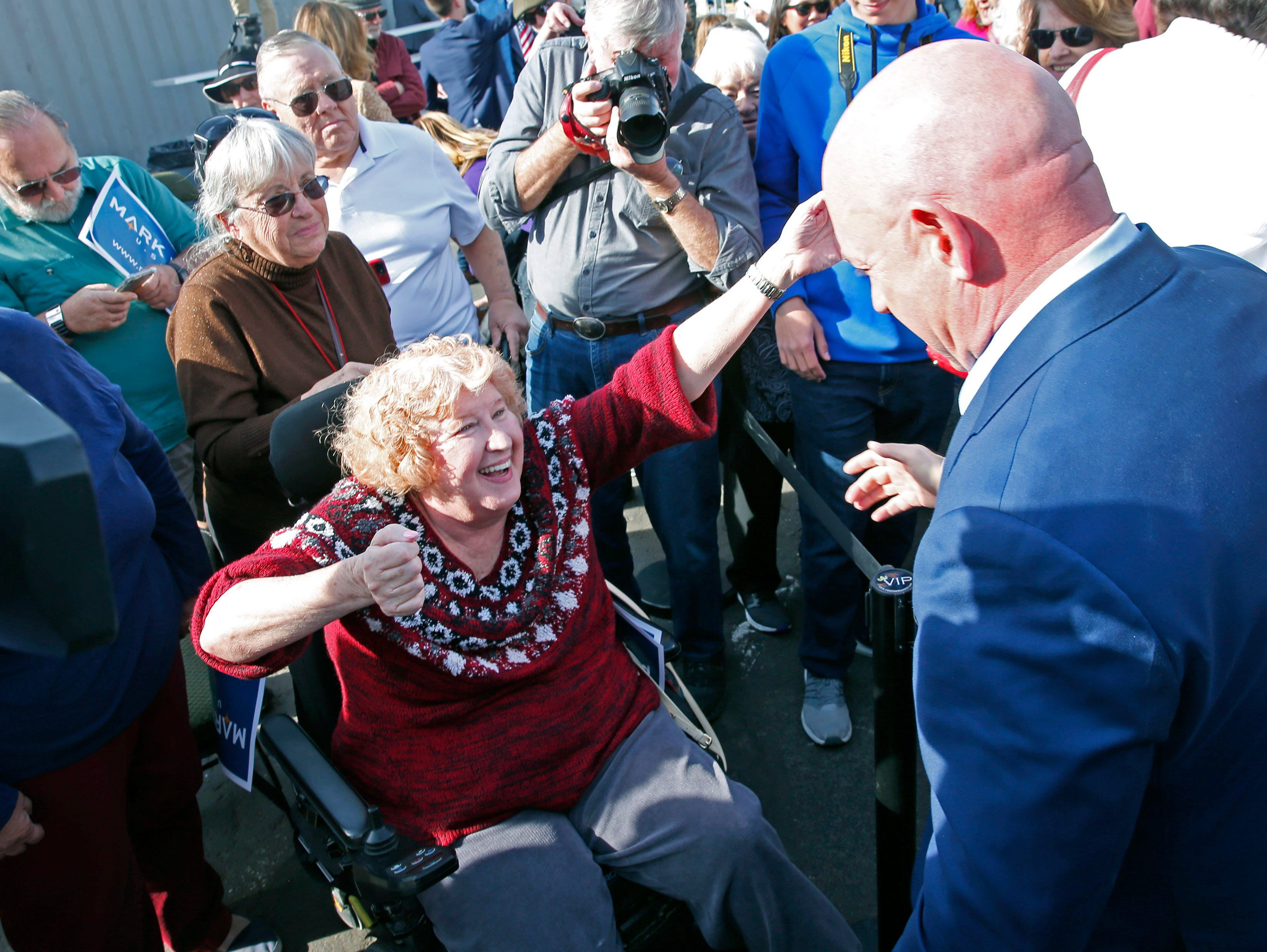 Bonnie Guzelf from Tempe greets Mark Kelly during a Senate launch event in Phoenix, Ariz. on Feb. 24, 2019. Kelly is running as a Democrat for the late Sen. John McCain's seat.