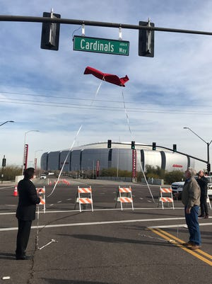 Cardinals President Michael Bidwill (left) and Glendale Mayor Jerry Weiers unveil the new street sign for Cardinals Way near State Farm Stadium.