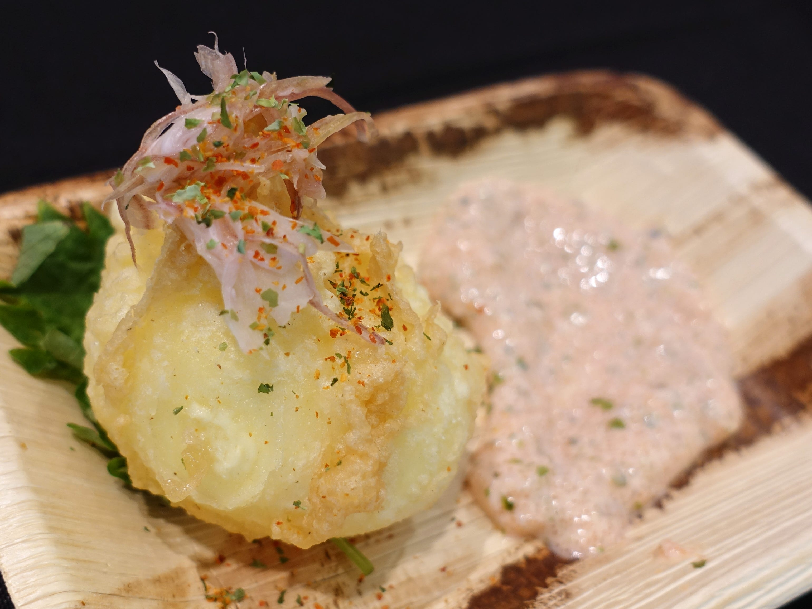 Hana Tamago with dashi brined soft-boiled egg, tempura fried, with mentaiko yogurt sauce and pickled myoga from Hana Japanese Eatery at the 2019 Devour Culinary Classic at the Desert Botanical Garden in Phoenix.