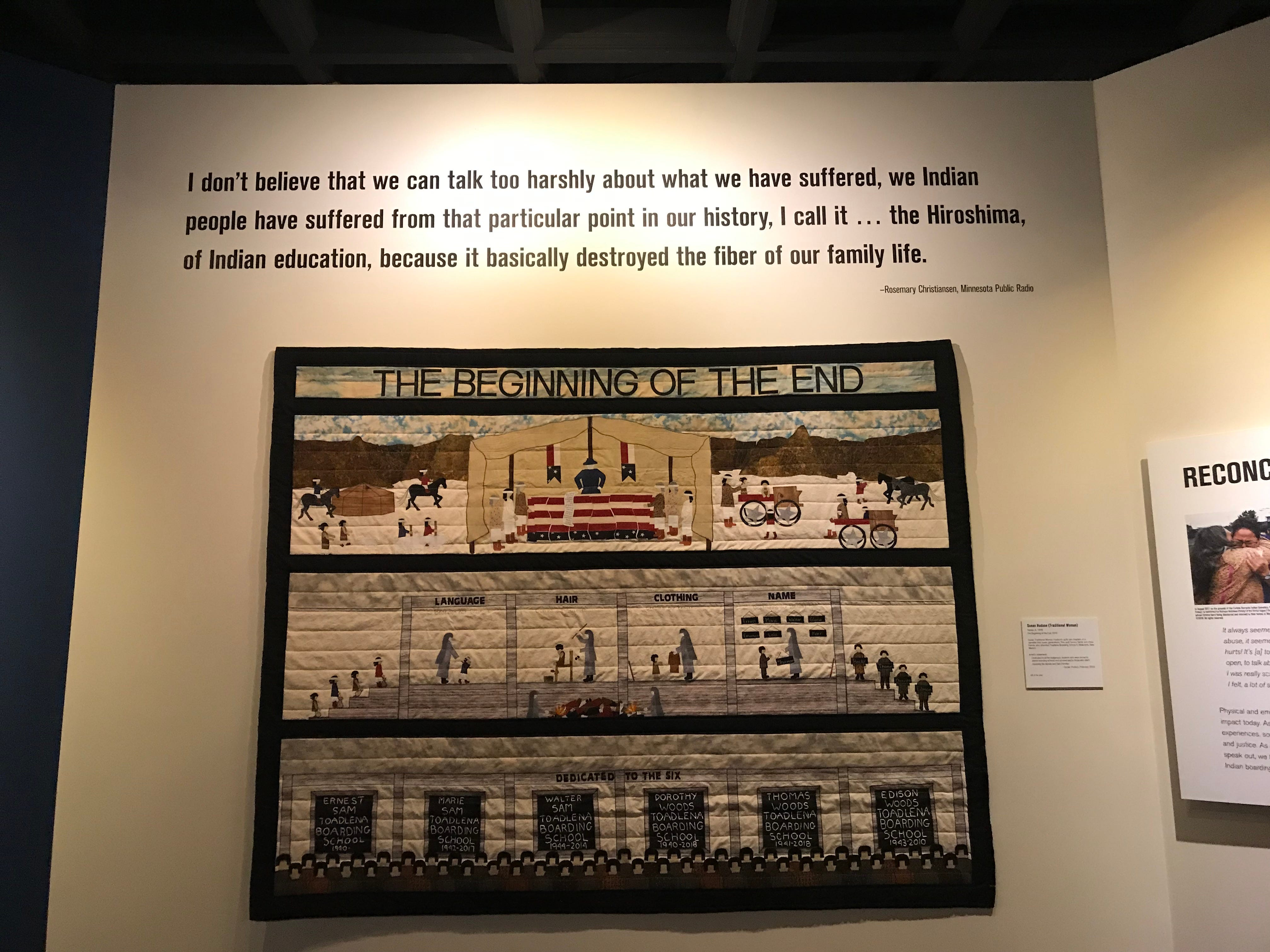 """Navajo weaver Susan Hudsan made a quilt in honor of her family who went to boarding schools. The quilt is part of the Heard Museum's """"Away From Home: American Indian Boarding School Stories"""" exhibit."""