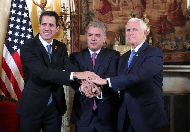 El auto proclamado presidente interino de Venezuela, Juan Guaidó, junto al presidente de Colombia Iván Duque y el vicepresidente Mike Pence durante la reunión del Grupo de Lima.
