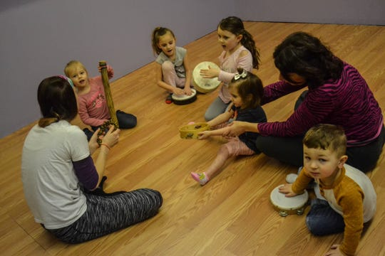 Students experiment with various instruments during a Kindermusik class at Rhythms on the Lake Studios, which uses music and movement to educate and inspire kids. From left are Kindermusik educator Taylor Fletcher, Cassidy Goodwin, Aletheia Hild, Anjelica Kreusch, Stella Benson, Kindermusik educator Jen Nickel, and Carson Sorgen.