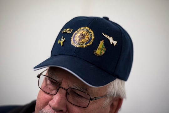 Pins decorate an American Legion hat worn by Ray Carrier as he discusses the Chas. A. Hammond, American Legion Post #8's history Thursday, Feb.  21, 2019 in one of the post's meeting rooms.