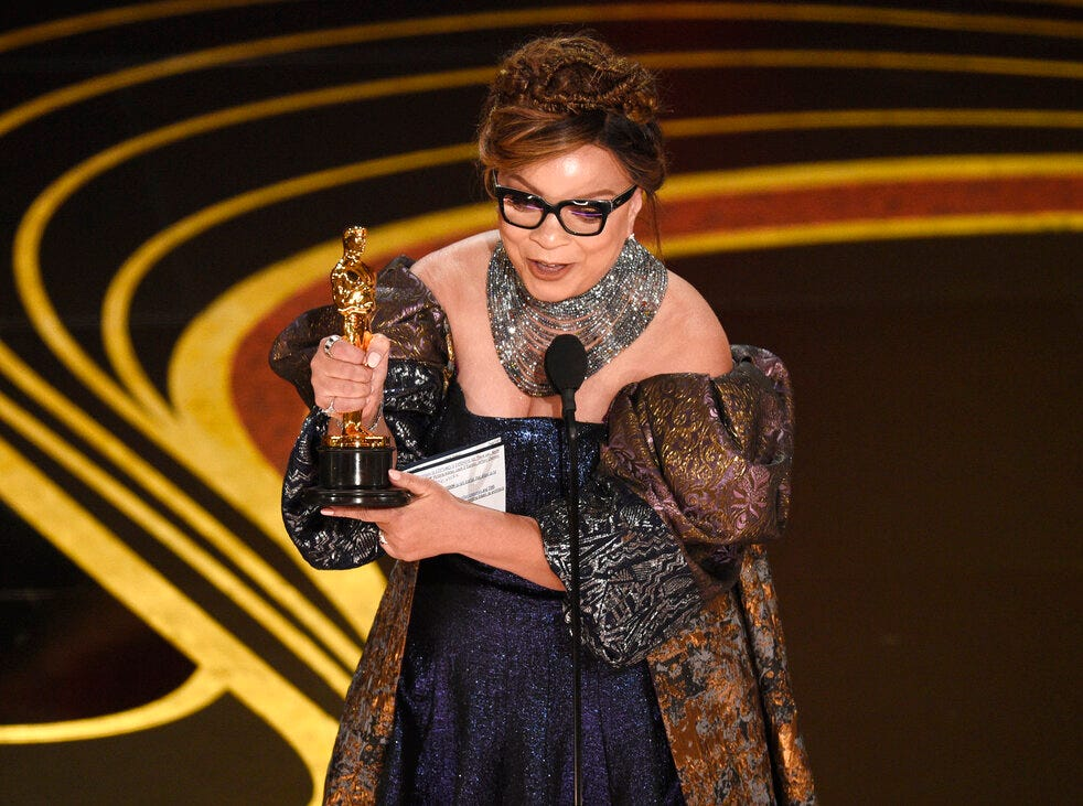 """Ruth E. Carter accepts the award for best costume design for """"Black Panther"""" at the Oscars on Sunday, Feb. 24, 2019, at the Dolby Theatre in Los Angeles. (Photo by Chris Pizzello/Invision/AP)"""