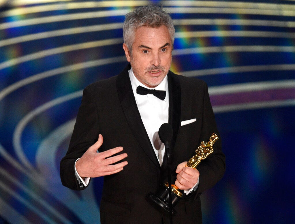 """Alfonso Cuaron accepts the award for best cinematography for """"Roma"""" at the Oscars on Sunday, Feb. 24, 2019, at the Dolby Theatre in Los Angeles. (Photo by Chris Pizzello/Invision/AP)"""