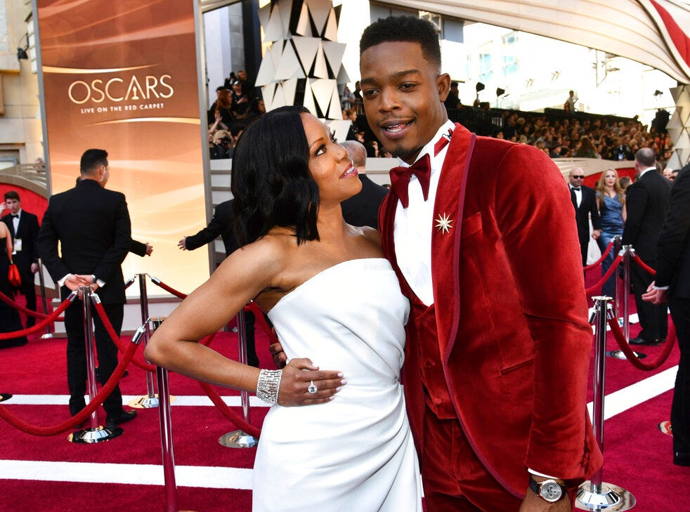 Regina King, left, and Stephan James arrive at the Oscars on Sunday, Feb. 24, 2019, at the Dolby Theatre in Los Angeles. (Photo by Charles Sykes/Invision/AP)
