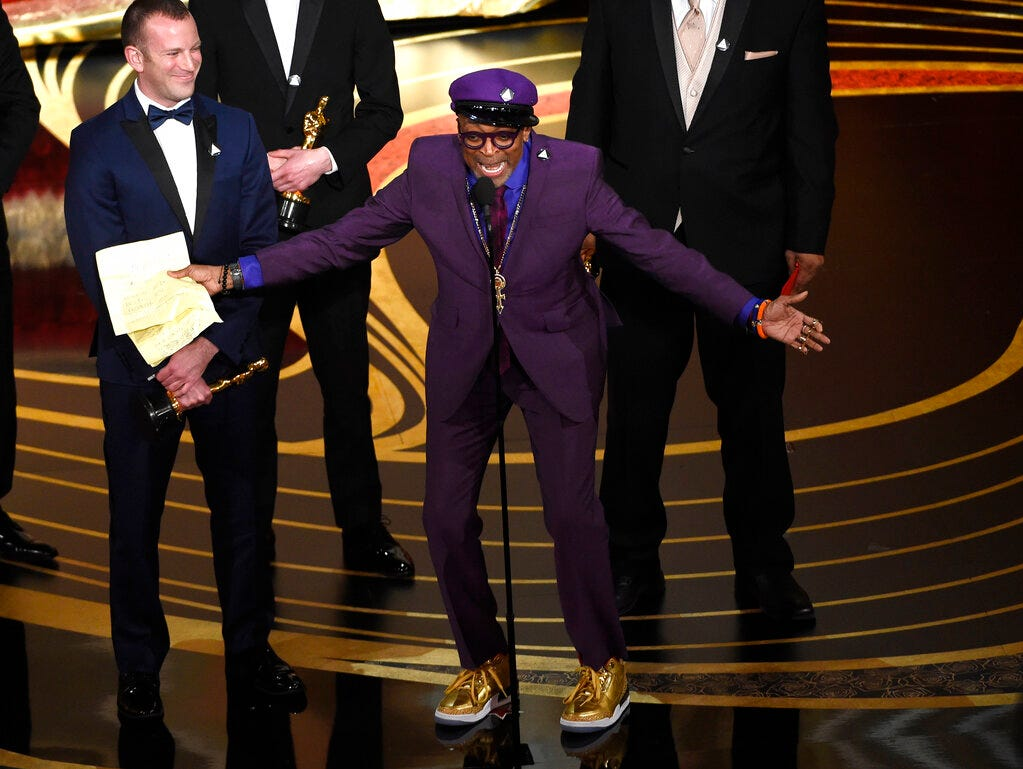 """Charlie Wachtel, left, and Spike Lee accept the award for best adapted screenplay for """"BlacKkKlansman"""" at the Oscars on Sunday, Feb. 24, 2019, at the Dolby Theatre in Los Angeles. (Photo by Chris Pizzello/Invision/AP)"""