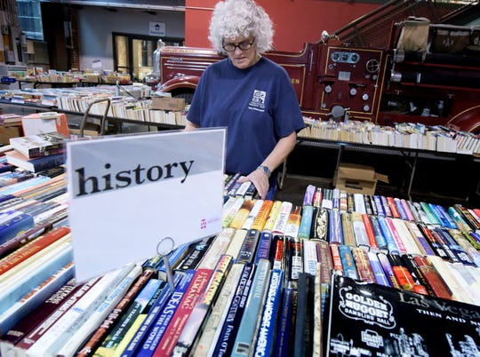 Lila Fourhman-Shaull, York County History Center director of Library & Archives, arranges books for the 17th annual Book Blast at the Agricultural and Industrial Museum Monday, Aug. 7, 2017. The book blast begins Thursday at 4 p.m. for center members, and is open to the public Friday from 9 a.m. to 6 p.m. and Saturday 9 a.m. to 2 p.m. Saturday features the Buck-a-Bag sales in which shoppers pay a dollar and can fill a bag with general category books. Bill Kalina photo