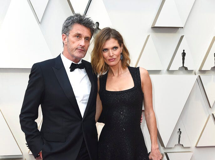 Pawel Pawlikowski, left, and Malgosia Bela arrive at the Oscars on Sunday, Feb. 24, 2019, at the Dolby Theatre in Los Angeles. (Photo by Jordan Strauss/Invision/AP)