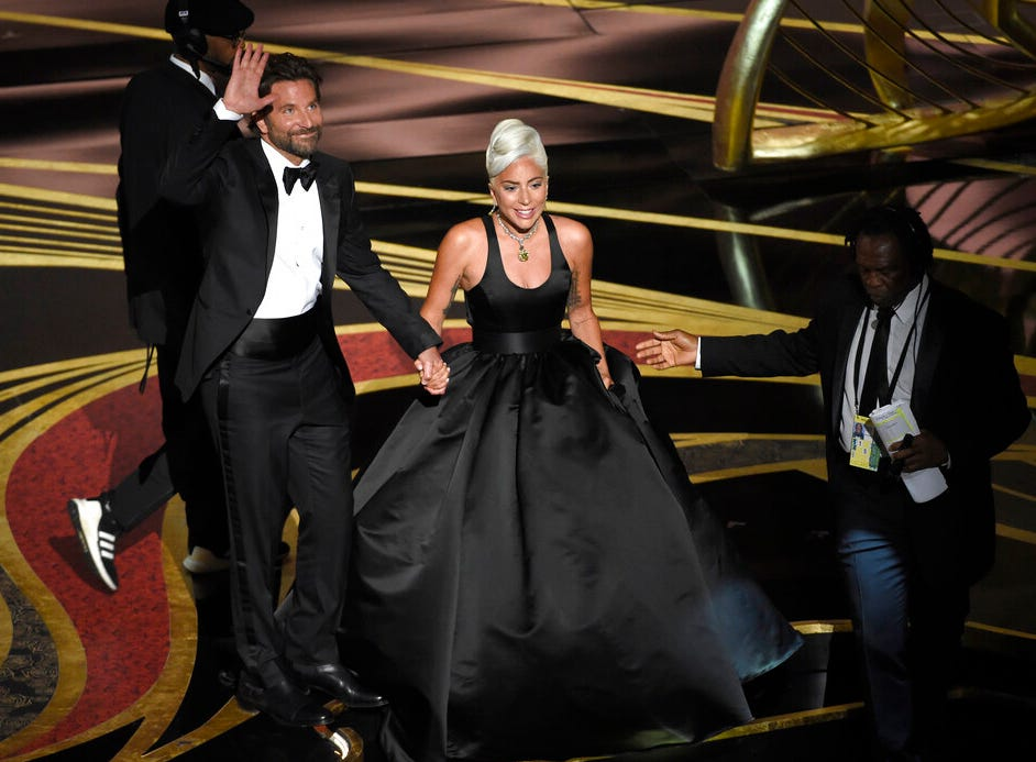 """Bradley Cooper, left, and Lady Gaga react to the audience after a performance of """"Shallow"""" from """"A Star is Born"""" at the Oscars on Sunday, Feb. 24, 2019, at the Dolby Theatre in Los Angeles. (Photo by Chris Pizzello/Invision/AP)"""