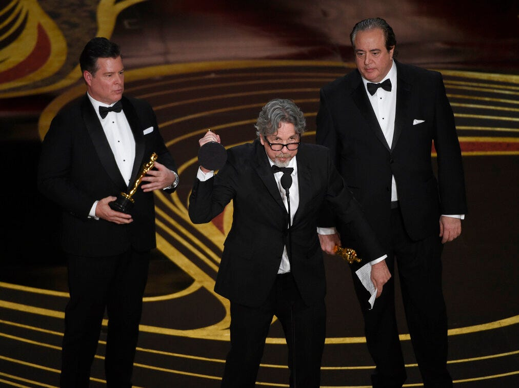 """Brian Hayes Currie, from left, Peter Farrelly and Nick Vallelonga accept the award for best original screenplay for """"Green Book"""" at the Oscars on Sunday, Feb. 24, 2019, at the Dolby Theatre in Los Angeles. (Photo by Chris Pizzello/Invision/AP)"""