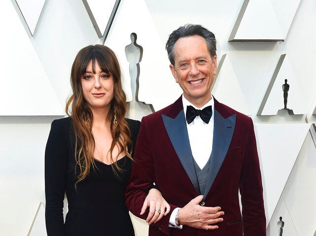 Olivia Grant, left, and Richard E. Grant arrive at the Oscars on Sunday, Feb. 24, 2019, at the Dolby Theatre in Los Angeles. (Photo by Jordan Strauss/Invision/AP)