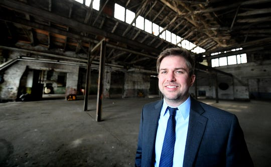 Dylan Bauer, Royal Square Development president of development, stands inside the former Pewtarex Foundry in York City Friday, Feb. 22, 2019. The property is being redeveloped by Royal Square. Bill Kalina photo
