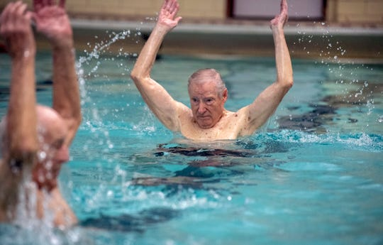 Jay Rentzel, 91, leads a Swimnastics class at the YMCA in York on Monday. Rentzel leads the class through 36 different positions that help with core strength.