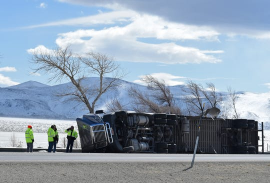 DOT officials tend to a rolled over high-profile vehicles on the 580 next Washoe Lake on Monday Feb 25, 2019. High wind are expected though the day.
